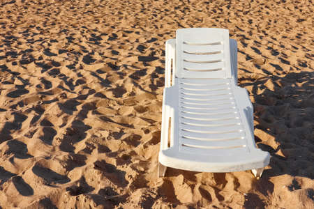 beach sunbed on the dune sand with a place for writing