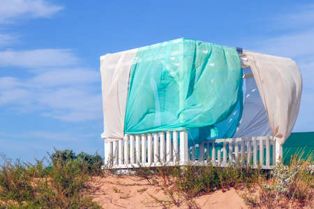 gazebo for relaxing on the dune sand with a place for writing