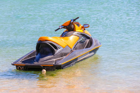 a jet ski stands on the water without people