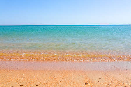 Soft Wave Of Blue Ocean On Sandy Beach. Background. Selective focus Фото со стока