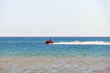 a man rides a jet ski in the open sea