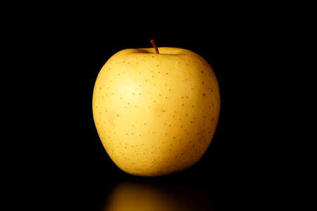 yellow Apple on a black background close-up.isolate