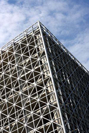 Abstract metallic building and blue sky photo