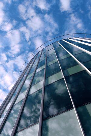 Modern glass architecture taken from below   photo