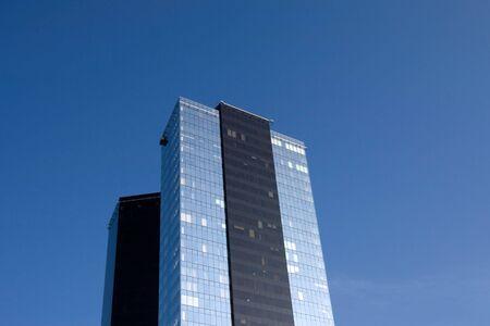 Two scyscrapers on blue sky background horizontal photo