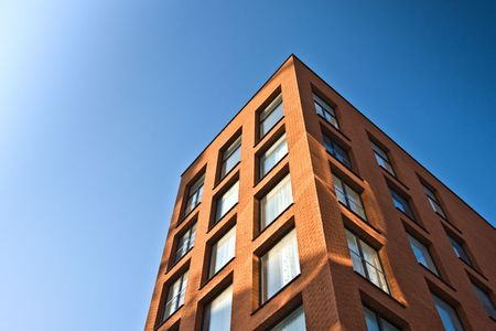 brick work: New office building with blue sky Stock Photo