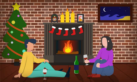 A couple sitting near fireplace, drinking wine in Christmas evening. Male and female sitting on the floor. Socks for presrnts, candles and fire