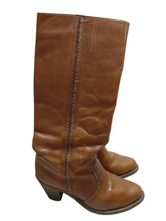 Women's brown leather boots from the 1970s. Knee high with stacked heel. White background. Stock Photo - 6097826