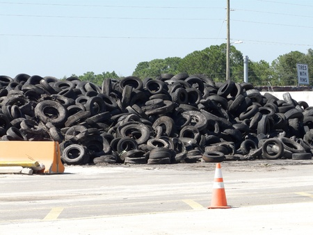 Pile of rimless tires on Recycle Alley at a landfill. The sign for tires with rims can be seen.