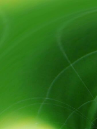 Computer-generated blurred abstract of a green world with rising sun.