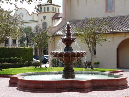 A Spanish fountain and architecture at a church and town square in Florida.