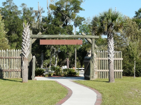 Wooden stockade style gate at Fort Fanning Historic Park, Florida  photo