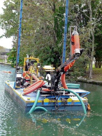 Water restoration dredging project is removing invasive algae from canals in Crystal River, Florida, habitat for the endangered Manatee.