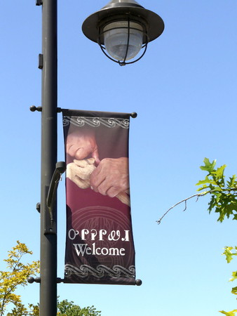 A banner hangs in Cherokee, North Carolina, entrance to the Great Smoky Mountains National Park, with Welcome in both Cherokee and English languages Editorial