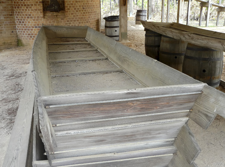 A turpentine still at St. Andrews State Park, Panama City, Florida, displays the barrels and trough used for rosin clarification. Editorial