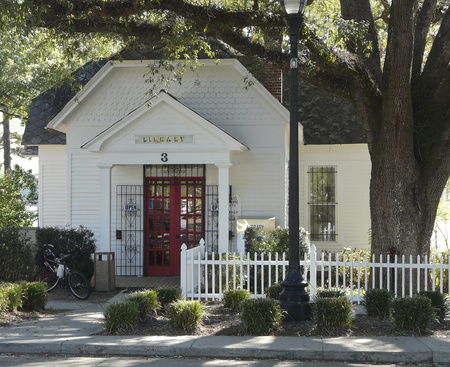 DEFUNIAK SPRINGS, FLORIDA - OCTOBER 18, 2016: Exterior of a historic library in a small American town. The Walton-Defuniak Library, established in 1886, is in DeFuniak Springs, Florida.