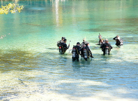 morrison: PONCE DE LEON, FLORIDA-OCTOBER 21, 2016: Men wearing wet suits and carrying air tanks on their backs are receiving scuba diving instruction at Morrison Springs Park, near Ponce De Leon, Florida.