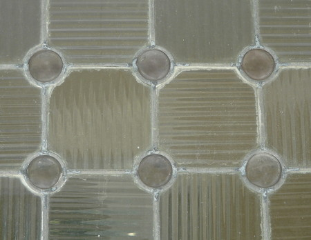 This antique glass window pane is an example of 1800s architecture, but could also serve as a unique background or abstract.
