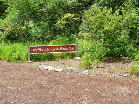 PINE MOUNTAIN, GEORGIA-JUNE 5, 2018: This sign at Callaway Gardens marks a trail whose purpose as an affiliate of the Lady Bird Johnson Wildflower Center in Austin, Texas, is to protect native plants. Editorial
