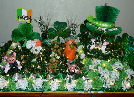 Lighted Saint Patrick's Day decorations feature green shamrocks, garland, carnations, gold clover, Irish top hat, mice, blarney stones, leprechauns.