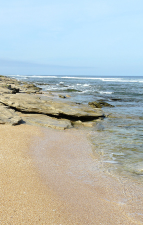 Coquina rock outcroppings and cinnamon-colored sand highlight the beach at Washington Oaks Gardens State Park, Florida.