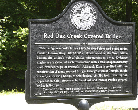 WOODBURY, GEORGIA-JUNE 6, 2018: Built in the 1840s by bridge builder Horace King, a former slave, the Red Oak Creek covered bridge is on the National Register of Historic Places, and open to traffic.