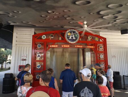 MERRITT ISLAND, FLORIDA-OCTOBER 31, 2019: Visitors wait to view Apollo/Saturn V Center exhibits related to the moon landing and other Apollo missions, such as the rocket, modules, and launch footage.
