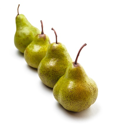 Four pears in a row isolated on white photo