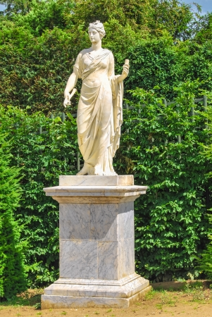 statue of Athena in the Gardens of Versailles, France photo