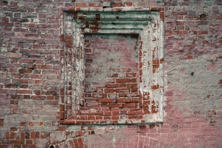 niche in old brick wall with ledges photo