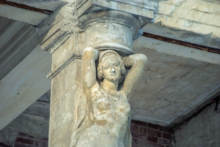 Stone statue, Caryatid, woman sculpture in palace photo