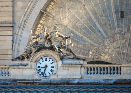 Clock on the facade of Gare de lEst (Eastern railway station), Paris, France photo