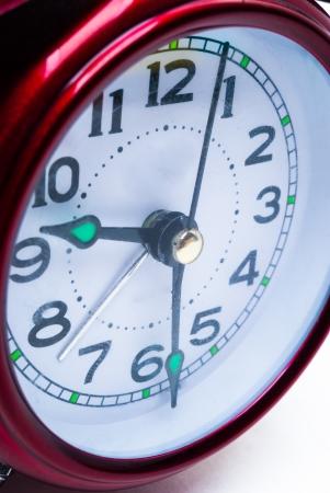 Red clock, close up photo