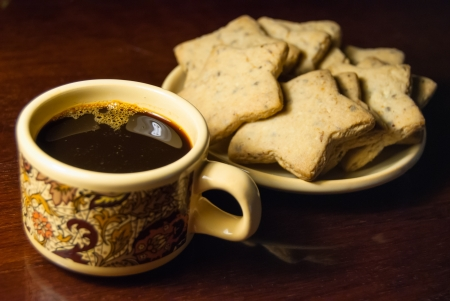 A cup of coffee and cookies on a table Reklamní fotografie - 21148940