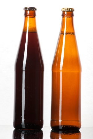 Two bottles of beer on white background photo