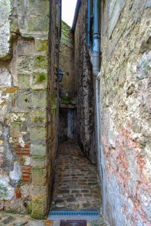 narrow street in Laon, France. Medieval walls in the old town. photo