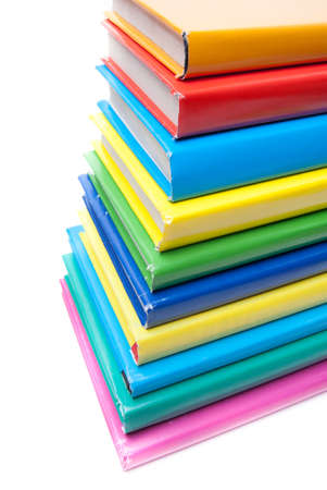 Colorful real books on white background photo