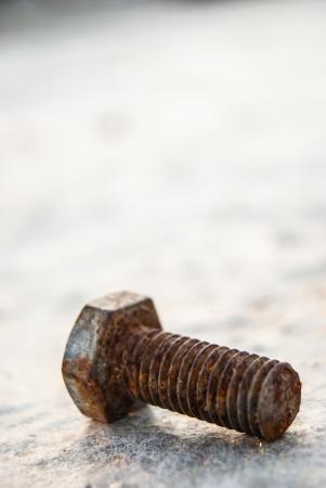 rusty bolt on concrete surface, building site photo