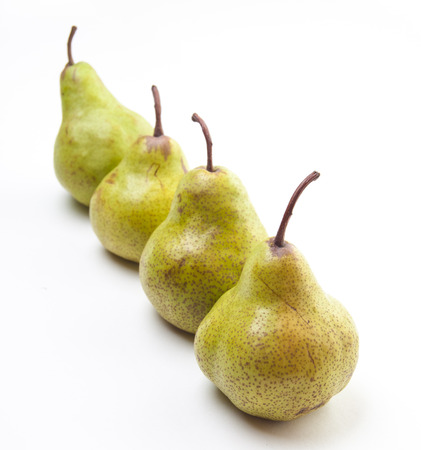 Four pears in a row isolated on white Stock Photo - 22818283
