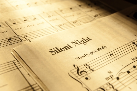 red sheet: sheet music for Silent Night, christmas song Stock Photo