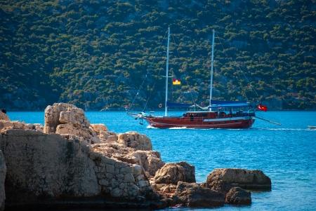 boat near ancient city in Kekova with turkish flag, Antalya, Turkey Stock Photo