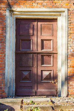 door in old brick house photo