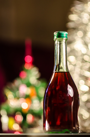 bottle of wine with christmas tree in background photo