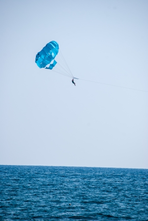 parasailing on sea photo