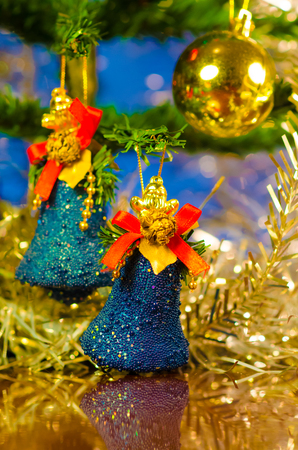 christmas bells near decorated tree Stock Photo - 23822293