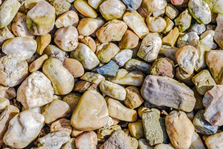 smooth stones on river bank, background texture photo