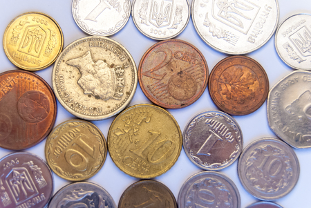 various coins on white paper photo