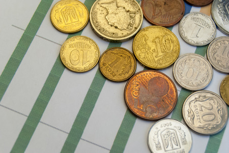 various coins on graph paper photo