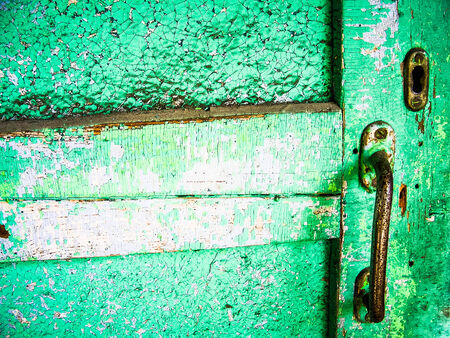 old wooden door painted with cracks, macro, vintage photo