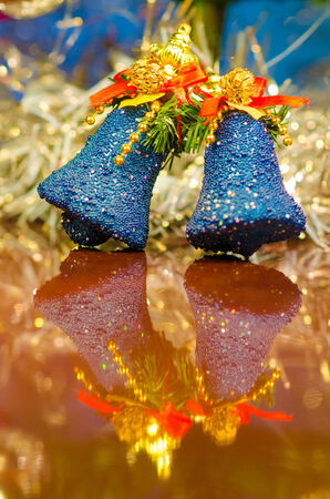 christmas bells near decorated tree photo